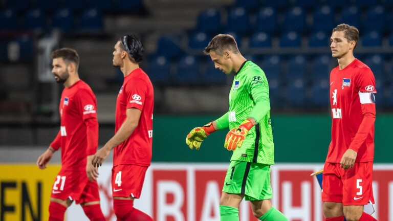 Marvin Plattenhardt, Karim Rikik, Alexander Schulw and Niklas Stark run sadly from the field after the DFB Cup defeat to Eintracht Braunschweig (Photo: City-Press GmbH)