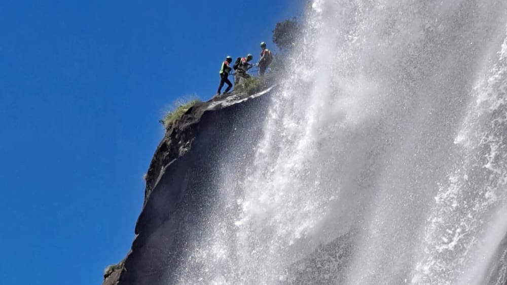 A woman (42) takes a selfie at Bergeller Waterfall, which is 50 meters deep