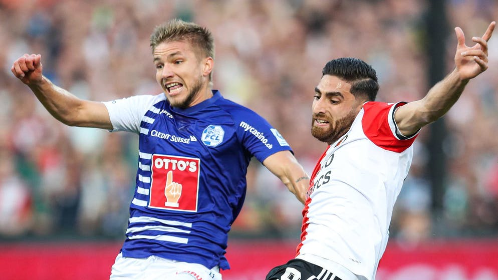 Alireza Jahanbakhsh (right) in a duel with Martin Friedk of Lucerne.