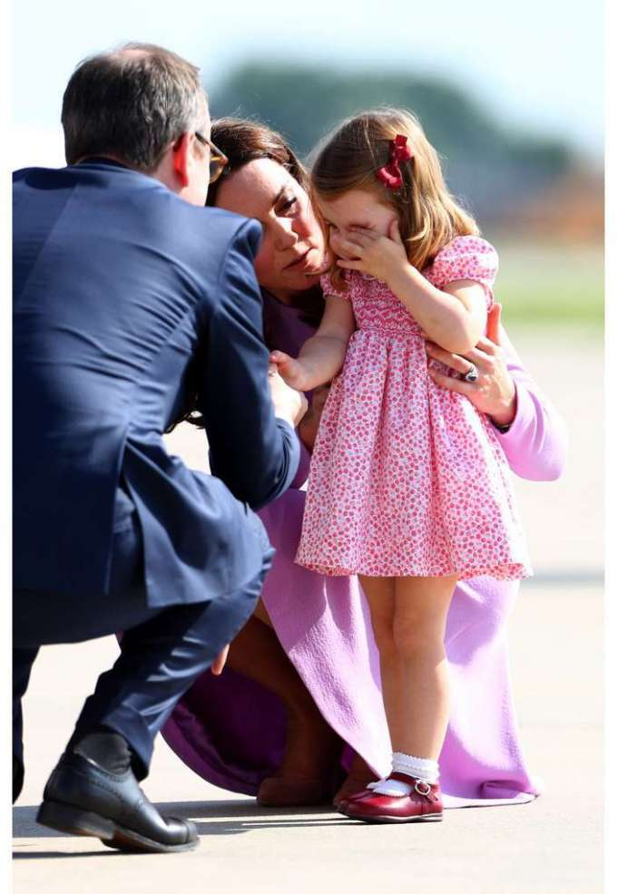 Being a mother isn't always easy: Kate has to comfort her daughter Charlotte here.