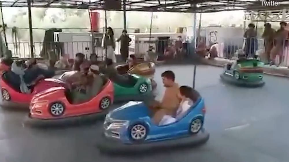 Taliban fighters celebrate in amusement park and fitness area