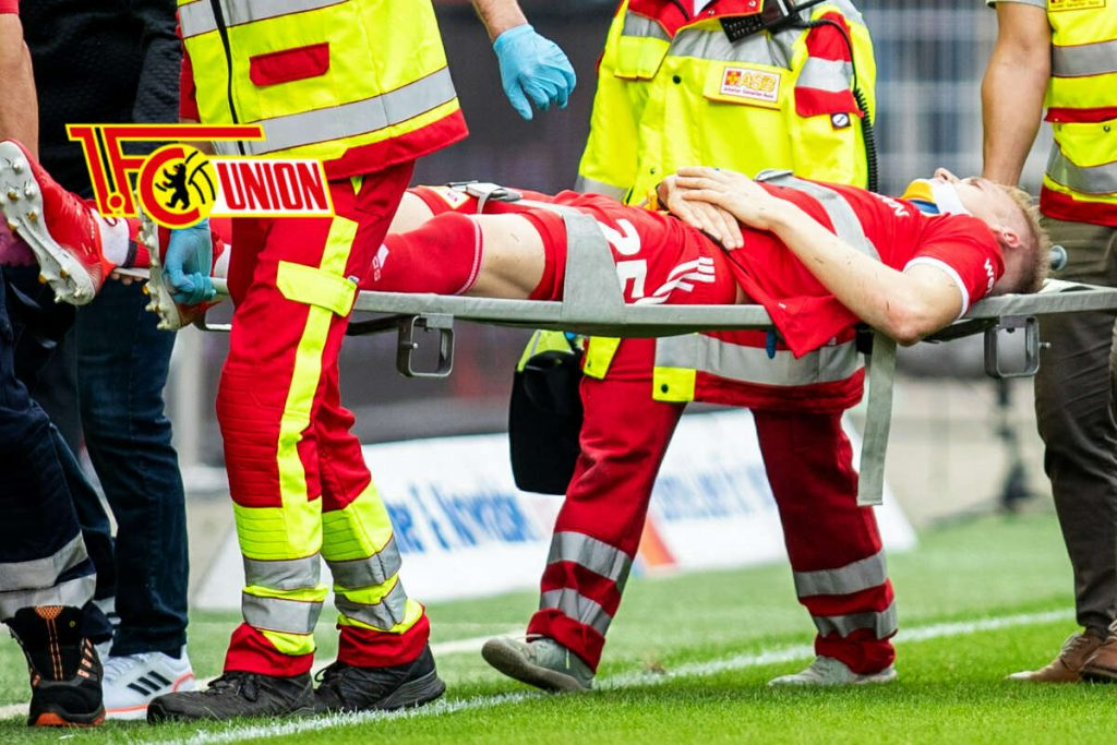 shock!  Federation newcomer Timo Baumgartel has to leave the field on a stretcher
