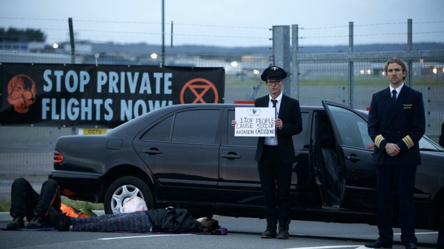 Climate activists block private airport in England