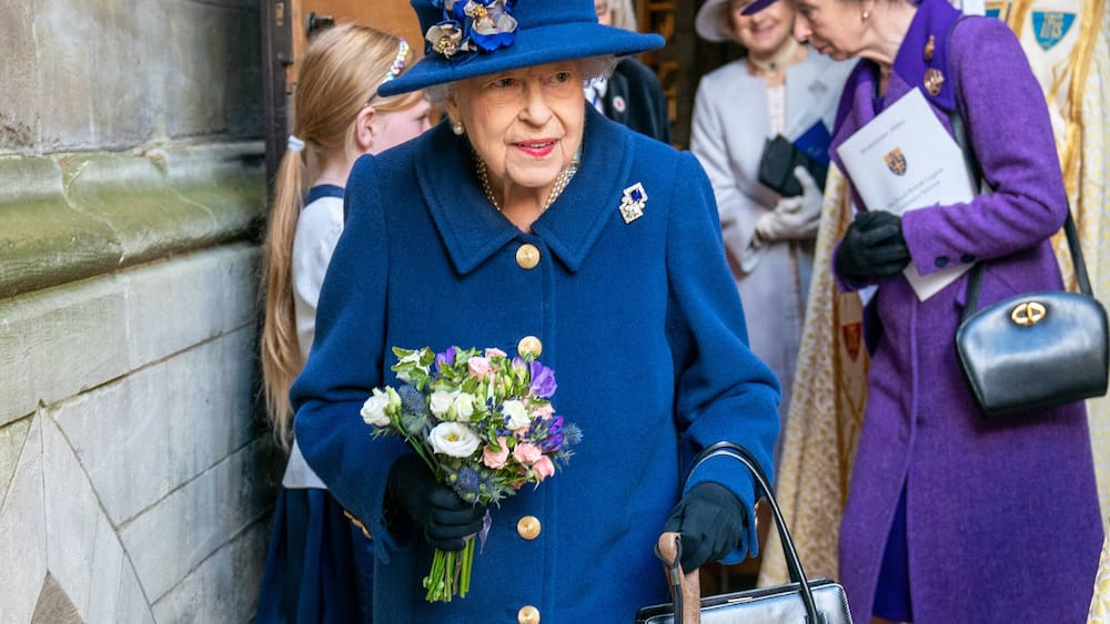 The Queen walks to church on a stick