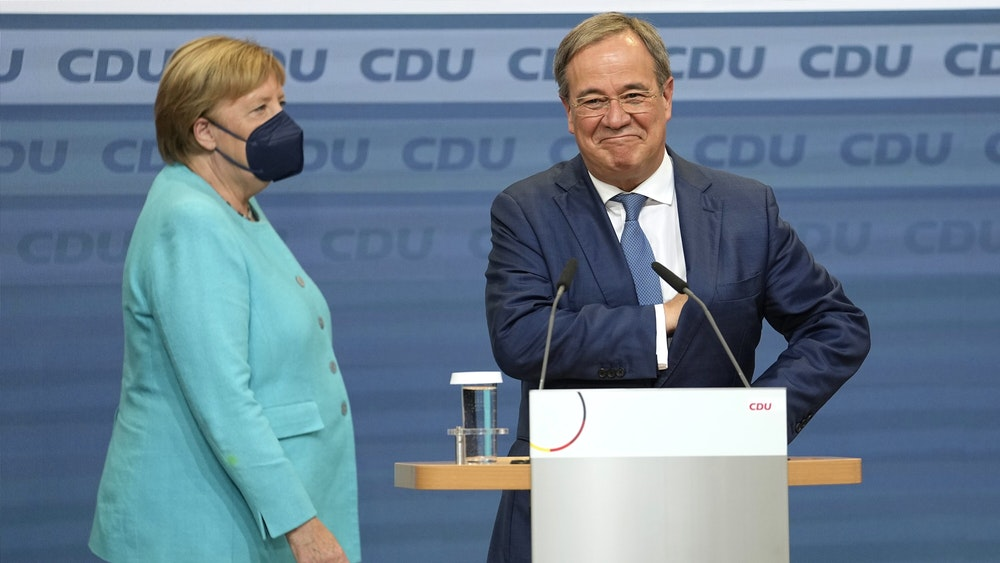 Will Armin Laschet become chancellor if Germans vote as in the US electoral system?  He stands here shortly after the September 26 election at Konrad-Adenauer-Haus next to Chancellor Merkel.